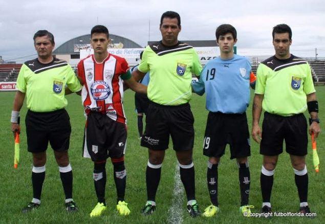 Eris Herrera, asistentes y capitanes de Salto y Flores. Foto Miguel Castagnaro